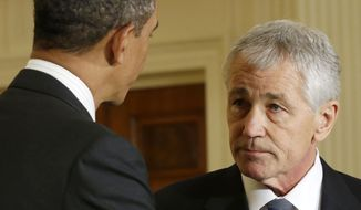 ** FILE ** In this Jan. 7, 2013, file photo, President Barack Obama shakes hands with Defense Secretary-nominee, former Nebraska Sen. Chuck Hagel, in the East Room of the White House in Washington. (AP Photo/Pablo Martinez Monsivais. File)