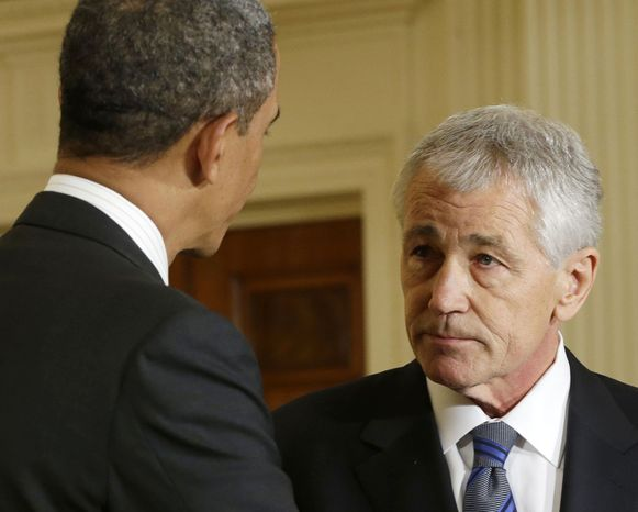 ** FILE ** In this Jan. 7, 2013, file photo, President Barack Obama shakes hands with Defense Secretary-nominee, former Nebraska Sen. Chuck Hagel, in the East Room of the Whit