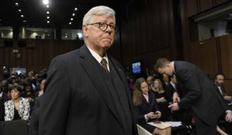 ** FILE ** National Rifle Association President David Keene arrives to attend the Senate Judiciary Committee hearing on gun violence on Capitol Hill in Washington, Wednesday, Jan. 30, 2013. (AP Photo/Susan Walsh)