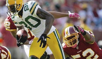 ASSOCIATED PRESS Washington Redskins linebacker Rocky McIntosh reaches for Green Bay Packers wide receiver Donald Driver during the second half of an NFL football game in Landover, Md., Sunday, Oct. 10, 2010.