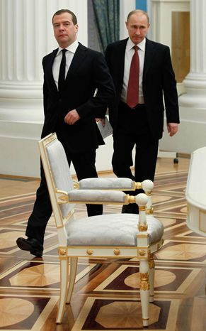 Russian President Vladimir Putin and Prime Minister Dmitry Medvedev, left, walk before a government meeting in the Kremlin in Moscow, Thursday, Jan. 31, 2013. (AP Photo/RIA-Novosti, Dmitry Astakhov, Governme