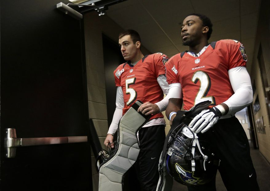 Baltimore Ravens quarterbacks Joe Flacco (5) and Tyrod Taylor walk out of a doorway for NFL football practice at the team's training facility in Owings Mills, Md., Friday, Jan. 25, 2013. The Ravens are scheduled to face the San Francisco 49ers in Super Bowl XLVII in New Orleans on Sunday, Feb. 3. (AP Photo/Patrick Semansky)