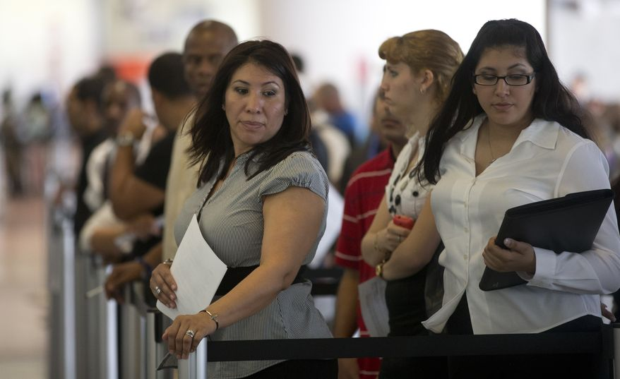 Norma Urbario (left) and America Rodriguez, holding their resumes, stand in line during a job fair hosted by the Miami Marlins at Marlins Park on Tuesday, Jan. 15, 2012, in Miami. (AP Photo/J. Pat Carter)