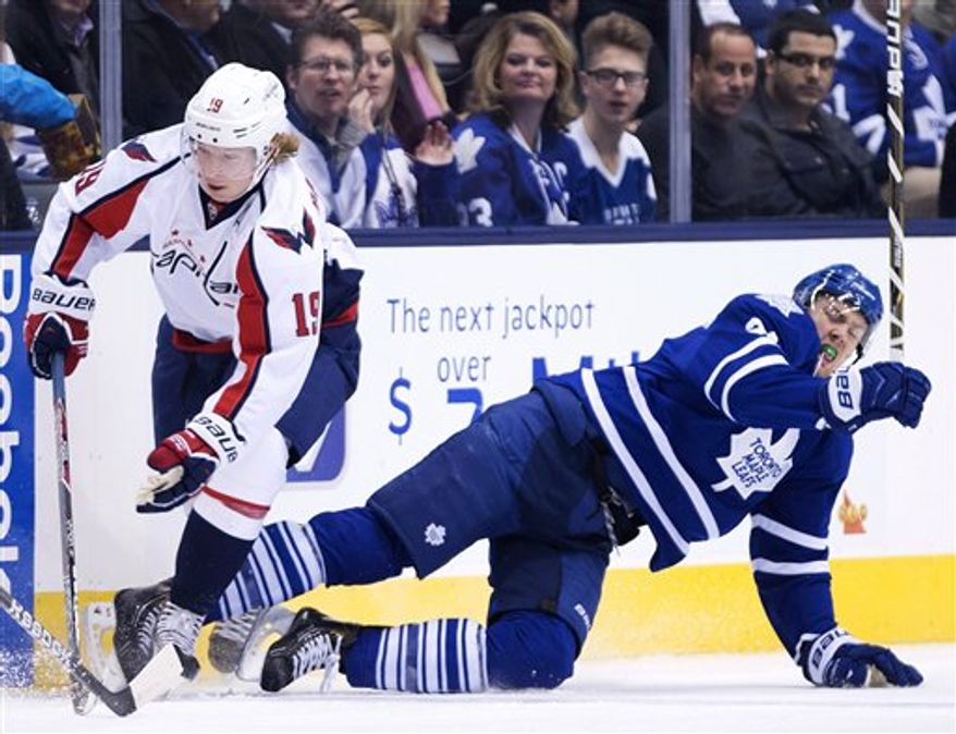 Toronto Maple Leafs forward James van Riemsdyk, right, gets taken out by Washington Capitals forward Nicklas Backstrom, left, during the first period of an NHL hockey game in Toronto on Thursday, Jan. 31, 2013. (AP Photo/The Canadian Press, Nathan Denette)