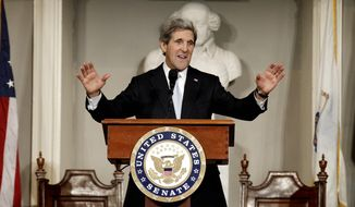 **FILE** U.S. Sen. John Kerry acknowledges applause while addressing constituents at Faneuil Hall in Boston on Jan. 31, 2013. (Associated Press)