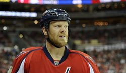 Washington Capitals defenseman John Erskine (4) looks on during the second period of an NHL hockey game against the Buffalo Sabres, Sunday, Jan. 27, 2013, in Washington. (AP Photo/Nick Wass)