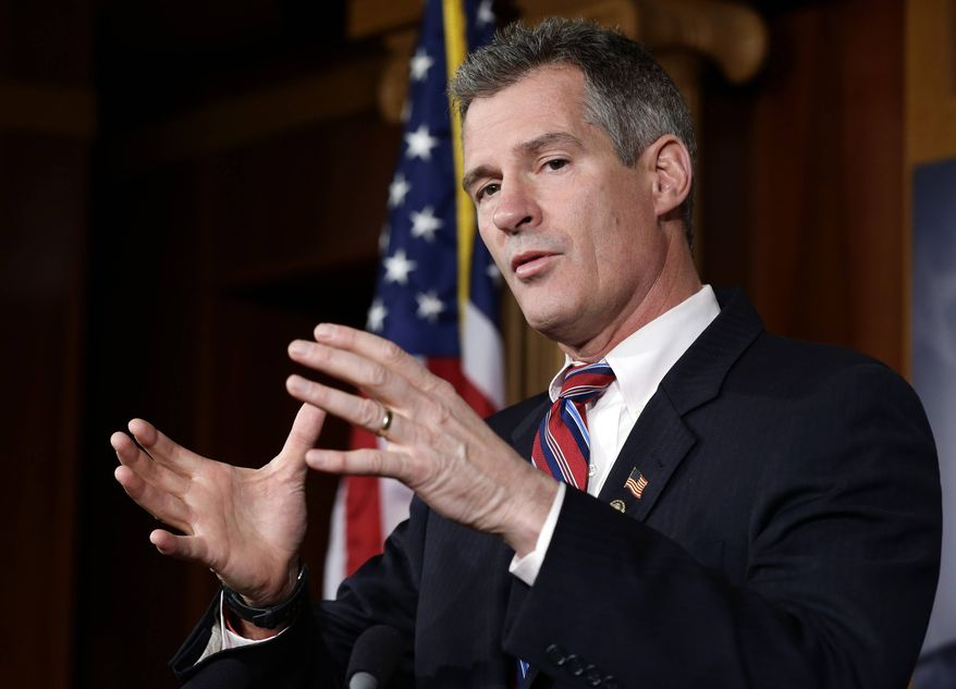 ** FILE ** In this Nov. 13, 2012, file photo, Sen. Scott Brown, R-Mass., speaks during a media availability, on Capitol Hill in Washington. Brown, who was defeated in his re-election bid, said Friday, Feb. 1, 2013, that he will not run for the Senate seat vacated by John Kerry, who was named secretary of state. (AP Photo/Alex Brandon, File)