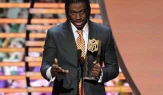 Robert Griffin III of the Washington Redskins accepts the award for AP Offensive Rookie of the Year presented by Pepsi Max at the 2nd Annual NFL Honors on Saturday, Feb. 2, 2013 in New Orleans. (Photo by AJ Mast/Invision/AP)