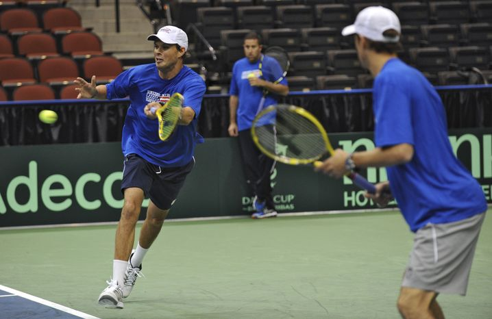 Mike Bryan, foreground, and Bob Bryan, of the United States, practice Thursday, Jan. 31, 2013, in Jacksonville, Fla., for this weekend's Davis Cup tennis match between Brazil and the United States. (AP Photo/The Florida Times-Union, Bob Mack)