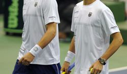 The United States' Bob Bryan, left, and Mike Bryan struggle in the fifth set after having their serve broken against Brazil's Marcelo Melo and Bruno Soares during their Davis Cup doubles tennis match in Jacksonville, Fla. on Saturday Feb. 2, 2013. (AP Photo/The Florida Times-Union, Bob Mack)