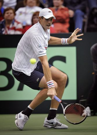 United States' John Isner returns a shot from Brazil's Thiago Alves during a first-round Davis Cup tennis match, Friday, Feb. 1, 2013, in Jacksonville, Fla. Isner won 6-3, 7-6 (4), 6-3. (AP