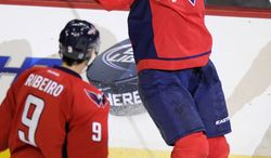 Washington Capitals left wing Wojtek Wolski (17), of Poland, celebrates his goal with teammate Mike Ribeiro (9) during the third period of an NHL hockey game against the Philadelphia Flyers, Friday, Feb. 1, 2013, in Washington. The Capitals won 3-2. (AP Photo/Nick Wass)