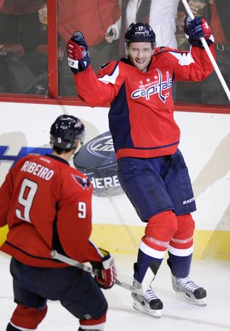 Washington Capitals left wing Wojtek Wolski (17), of Poland, celebrates his goal with teammate Mike Ribeiro (9) during the third period of an NHL hockey game against the Philadelphia Flyers, Friday, F