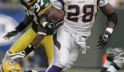 FILE - In this file photo, Minnesota Vikings running back Adrian Peterson (28) moves the ball during the first half of an NFL football game against the Green Bay Packers in Green Bay, Wis. Peterson has won The Associated Press 2012 NFL Offensive Player of the Year award just one year after major knee surgery. (AP Photo/Morry Gash, File)
