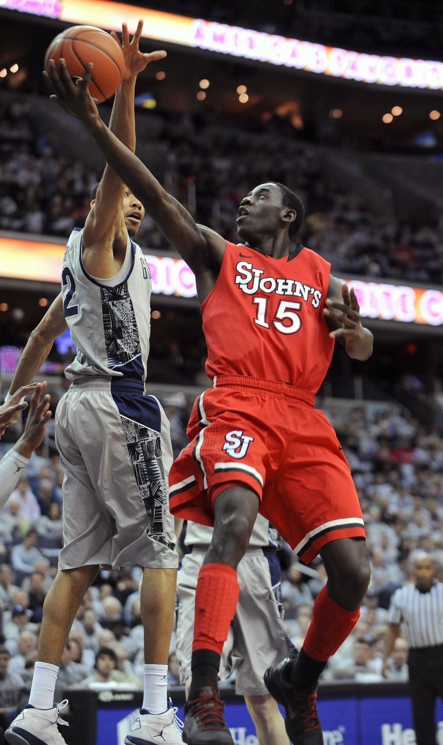 St. John's forward Sir'Dominic Pointer (15) goes up for a basket under pressure from Georgetown forward Otto Porter during first half of their NCAA college basketball game, Saturday, Feb. 2, 2013, in Washington. (AP Photo/Richard Lipski)