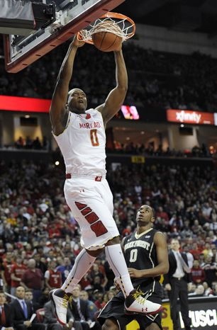 Maryland forward Charles Mitchell dunks over Wake Forest guard Codi Miller-McIntyre, right, during the second half of an NCAA college basketball game, Saturday, Feb. 2, 2013, in College Park, Md. Maryland won 86-60. (AP Photo/Nick Wass)