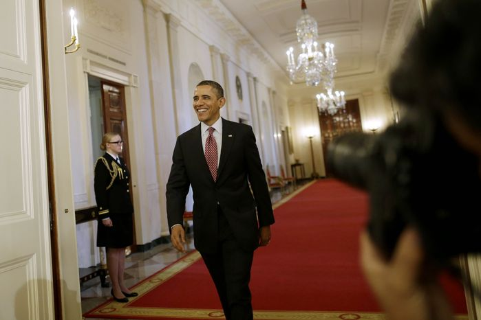 ** FILE ** President Barack Obama walks from the Cross Hall into the East Room of the White House in Washington, Friday, Feb. 1, 2013, to award the National Medal of Science and National Medal of Technology and Innovation to recipients at a ceremony. (AP Photo/Charles Dharapak)