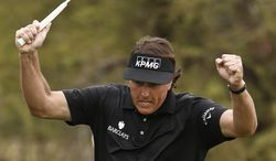 Phil Mickelson celebrates after making a long birdie putt on the seventh hole during the final round of the Waste Management Phoenix Open golf tournament on Sunday, Feb. 3, 2013, in Scottsdale, Ariz. (AP Photo/Ross D. Franklin)
