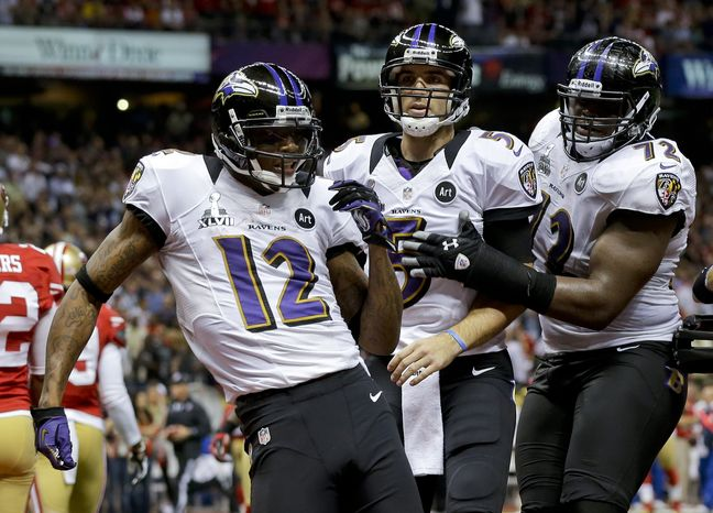Baltimore Ravens wide receiver Jacoby Jones (12) celebrates his 56-yard touchdown with quarterback Joe Flacco (5) and Kelechi Osemele (72) during the first half of the NFL Super Bowl XLVII football game against the San Francisco 49ers, Sunday, Feb. 3, 2013, in New Orleans. (AP Photo/Dave Martin)