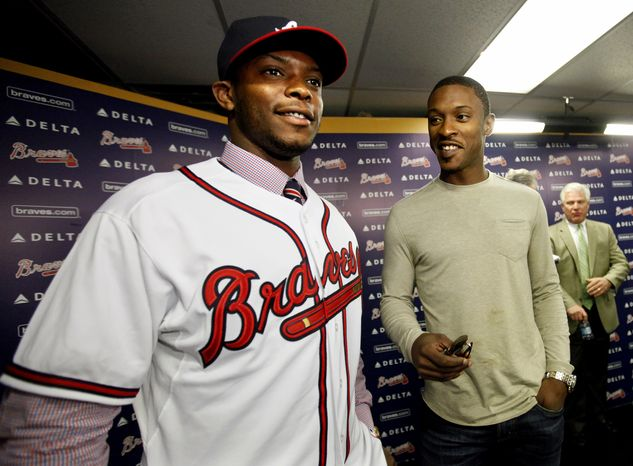 Justin Upton, left, acquired by the Atlanta Braves from the Arizona Diamondbacks in a seven-player deal last week, stands with his brother B.J, Upton, right, who signed a five-year, $75.25 million contract with Atlanta in November, at Justin's first Atlanta news conference, Tuesda