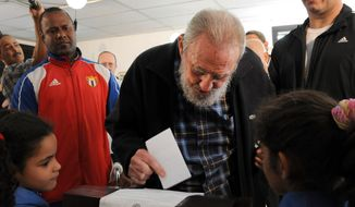 Former Cuban leader Fidel Castro casts his ballot at a polling station during parliamentary elections in Havana on Sunday, Feb. 3, 2013. Castro, who appears in public only occasionally, was among more than 8 million islanders eligible to vote and approve 612 members of the National Assembly and more than 1,600 provincial delegates. (AP Photo/Ismael Francisco, Cubadebate)