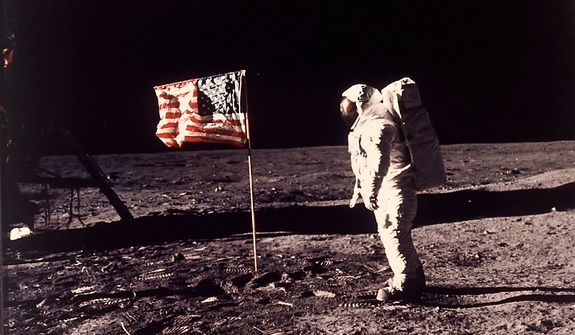 "Astronaut Edwin E. ""Buzz"" Aldrin Jr.  poses for a photograph beside the U.S. flag deployed on the moon during the Apollo 11 mission on July 20, 1969.  (AP Photo/NASA/Neil A. Armstrong)