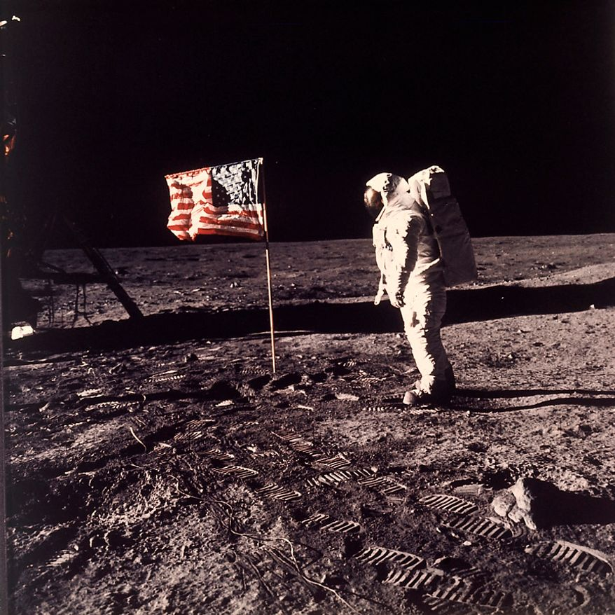 """Astronaut Edwin E. """"Buzz"""" Aldrin Jr.  poses for a photograph beside the U.S. flag deployed on the moon during the Apollo 11 mission on July 20, 1969.  (AP Photo/NASA/Neil A. Armstrong) Conspiracy theorists have claimed that photos of the lunar landings are bogus due to: a lack of visible stars; inconsistent shadows and lighting that seem to track with a studio production; what looks like the letter """"C†written on a moon rock and the lunar surface; an Australian woman's alleged claim that she saw a soft drink bottle in the frame while watching one of the manned landings take place on live television. NASA has provided plausible explanations for all of the above: Stars weren't visible due to the brightness of the sun during the lunar daytime; inconsistent shadows and lighting were the result of lens distortion, lunar dust, uneven ground and multiple light sources; the """"C†shape does not appear in original lunar camera film and is believed to be a coiled hair that made its way into the printing processes"""