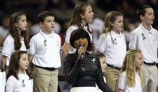 "Jennifer Hudson, center, sings ""God Bless America"" before the NFL Super Bowl XLVII football game between the San Francisco 49ers and the Baltimore Ravens, Sunday, Feb. 3, 2013, in New Orleans. (AP Photo/Evan Vucci) ** FILE **"