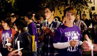 Young people participate in an anti-gay-bullying candlelight vigil at the Center Project in Columbia, Mo., on Oct. 20, 2010, to commemorate the recent deaths of gay teens. (AP Photo/The Columbia Daily Tribune, Joshua A. Bickel, File)
