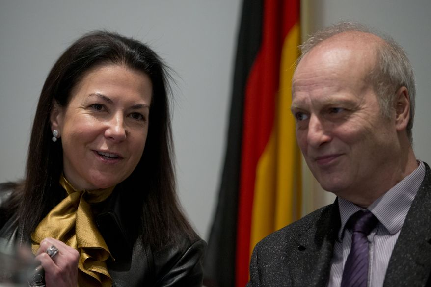"""Eurojust president Michele Coninsx, left, and Friedhelm Althans, chief investigator of the Bochum police in Germany, talk at the start of a press conference on findings of a probe into match fixing, in The Hague, Netherlands, Monday Feb. 4, 2013. The European police agency is unveiling results of a major investigation across the continent into match fixing in football, including what it is calling """"top international games."""" The presentation will likely be one of the most comprehensive overviews yet of rigging games. Investigators from Germany, Finland, Hungary and Slovenia are presenting the results of probes into the murky world of fixing matches and the huge sums of money involved. Football already has been rocked by several match-fixing cases, most notably in Germany and Italy. (AP Photo/Peter Dejong)"""