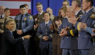 President Obama greets law enforcement officers before taking the stage to speak on ideas to reduce gun violence Monday in Minneapolis. He tried to channel a bipartisan sentiment similar to the message of a group of college presidents. (Associated Press)