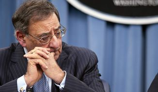 **FILE** Defense Secretary Leon Panetta listens during a news conference at the Pentagon on Jan. 24, 2013, where he announced he is lifting a ban on women serving in combat. (Associated Press)