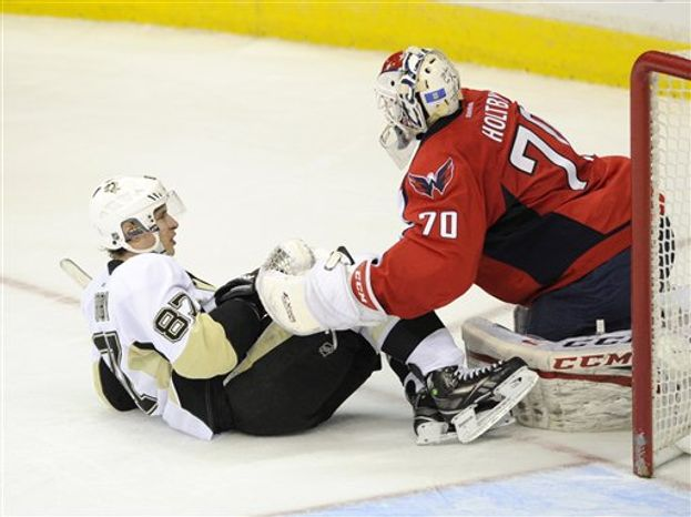 Capitals goaltender Braden Holtby allowed five goals on the first 14 shots Sunday against Sidney Crosby and the Penguins on Sunday, Feb. 3. (Associated Press)
