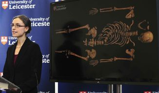 "Jo Appleby, a lecturer in Human Bioarchaeology, at University of Leicester, School of Archaeology and Ancient History, who led the exhumation of the remains found during a dig at a Leicester car park, speaks at the university Monday, Feb. 4, 2013. Tests have established that a skeleton found, pictured behind, are ""beyond reasonable doubt"" the long lost remains of England's King Richard III, missing for 500 years. (AP Photo/Rui Vieira, PA)"
