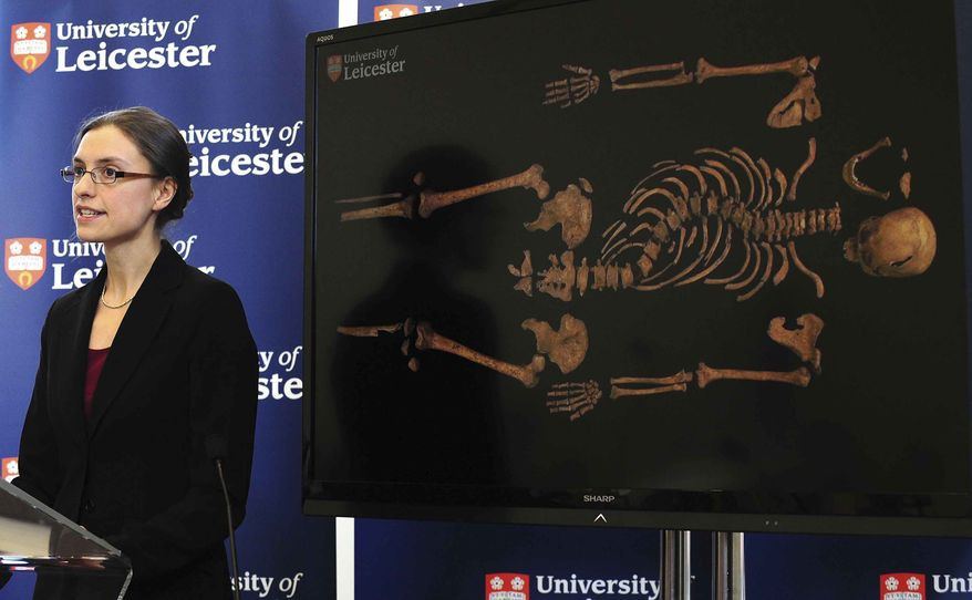"""Jo Appleby, a lecturer in Human Bioarchaeology, at University of Leicester, School of Archaeology and Ancient History, who led the exhumation of the remains found during a dig at a Leicester car park, speaks at the university Monday, Feb. 4, 2013. Tests have established that a skeleton found, pictured behind, are """"beyond reasonable doubt"""" the long lost remains of England's King Richard III, missing for 500 years. (AP Photo/Rui Vieira, PA)"""