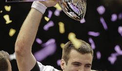 Baltimore Ravens quarterback Joe Flacco (5) holds up the Vince Lombardi Trophy after defeating the San Francisco 49ers 34-31 in the NFL Super Bowl XLVII football game Sunday, Feb. 3, 2013, in New Orleans. (AP Photo/Patrick Semansky)
