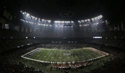 Fans and members of the Baltimore Ravens and San Francisco 49ers wait for power to return in the Superdome during an outage in the second half of the NFL Super Bowl XLVII football game, Sunday, Feb. 3, 2013, in New Orleans. (AP Photo/Charlie Riedel)
