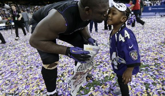 Baltimore Ravens fullback Vonta Leach celebrates with his daughter Giselle after their 34-31 win against the San Francisco 49ers in the NFL Super Bowl XLVII football game, Sunday, Feb. 3, 2013, in New Orleans. (AP Photo/Marcio Sanchez)