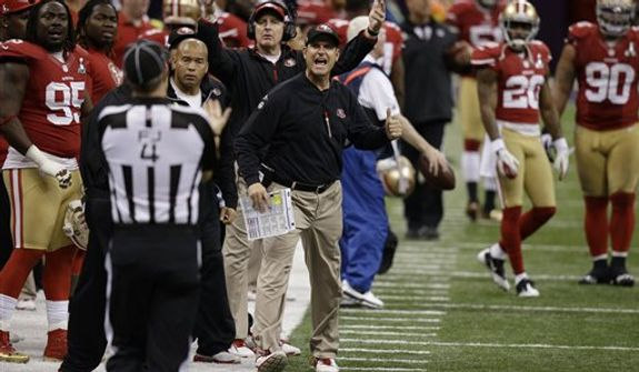 San Francisco 49ers head coach Jim Harbaugh argues with field judge Craig Wrolstad during the second half of the NFL Super Bowl XLVII football game Sunday, Feb. 3, 2013, in New Orleans. (AP Photo/Gene Puskar)