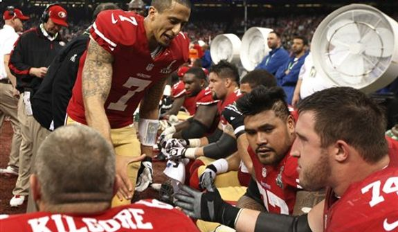 San Francisco 49ers quarterback Colin Kaepernick (7) shakes hands with offensive lineman Joe Staley (74) during the second half of the NFL Super Bowl XLVII football game against the Baltimore Ravens, Sunday, Feb. 3, 2013, in New Orleans. (AP Photo/Evan Vucci)