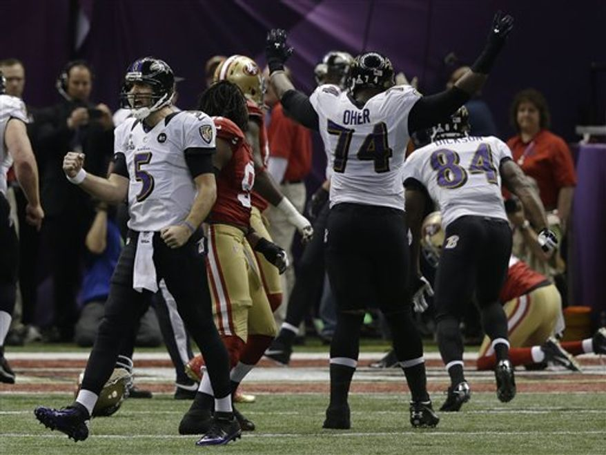Baltimore Ravens quarterback Joe Flacco (5) reacts after throwing a 1-yard touchdown pass to tight end Dennis Pitta against the San Francisco 49ers during the first half of the NFL Super Bowl XLVII football game, Sunday, Feb. 3, 2013, in New Orleans. (AP Photo/Elise Amendola)