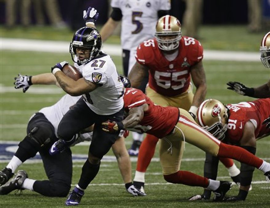 Baltimore Ravens running back Ray Rice (27)  rushes against San Francisco 49ers safety Donte Whitner (31) during the first half of the NFL Super Bowl XLVII football game Sunday, Feb. 3, 2013, in New Orleans. (AP Photo/Gene Puskar)