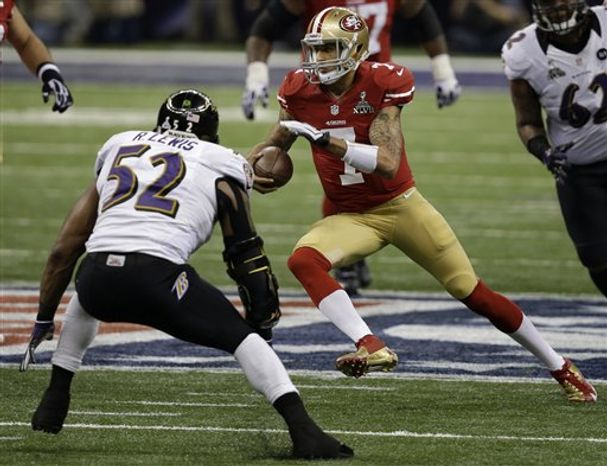 San Francisco 49ers quarterback Colin Kaepernick (7) runs against Baltimore Ravens linebacker Ray Lewis (52) during the first half of NFL Super Bowl XLVII football game Sunday, Feb. 3, 2013, in New Orleans. (AP Photo/Elaine Thompson)