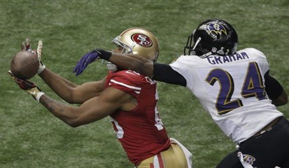 San Francisco 49ers wide receiver Michael Crabtree (15) cannot make the reception as Baltimore Ravens cornerback Corey Graham (24) defends during the second half of the NFL Super Bowl XLVII football game, Sunday, Feb. 3, 2013, in New Orleans.  (AP Photo/Charlie Riedel)