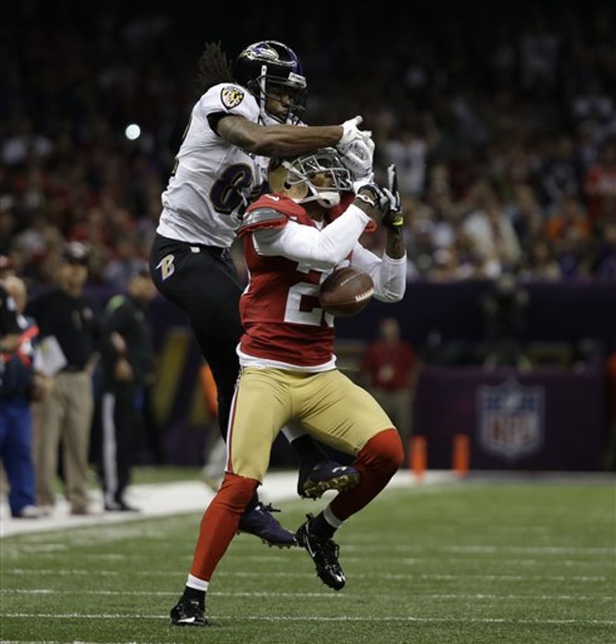 San Francisco 49ers defensive back Chris Culliver (29) breaks up a pass intended for Baltimore Ravens wide receiver Torrey Smith (82) during the first half of the NFL Super Bowl XLVII football game Sunday, Feb. 3, 2013, in New Orleans. (AP Photo/Matt Slocum)