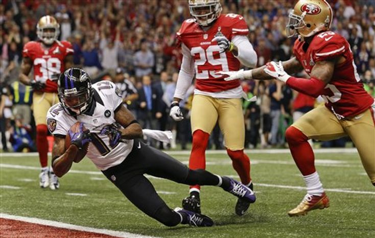 Baltimore Ravens wide receiver Jacoby Jones (12) crosses the goal line for a touchdown against San Francisco 49ers defensive back Chris Culliver (29) and cornerback Tarell Brown (25) in the second quarter of the NFL Super Bowl XLVII football game, Sunday, Feb. 3, 2013, in New Orleans. (AP Photo/Julio Cortez)
