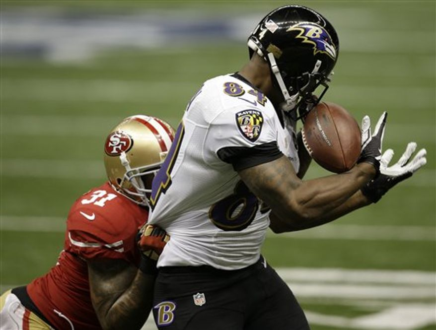 Baltimore Ravens tight end Ed Dickson (84) makes a catch against San Francisco 49ers safety Donte Whitner (31) during the first half of NFL Super Bowl XLVII football game, Sunday, Feb. 3, 2013, in New Orleans. (AP Photo/Elaine Thompson)