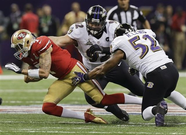San Francisco 49ers quarterback Colin Kaepernick (7) is tackled by Baltimore Ravens defensive end Haloti Ngata (92) and linebacker Ray Lewis (52) in the first quarter of the NFL Super Bowl XLVII football game, Sunday, Feb. 3, 2013, in New Orleans. (AP Photo/Dave Martin)