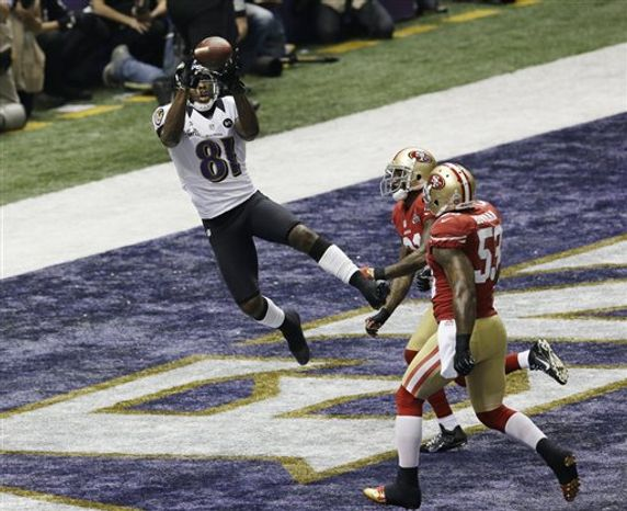 Baltimore Ravens wide receiver Anquan Boldin (81) catches a pass for a touchdown as San Francisco 49ers linebacker NaVorro Bowman (53)  and teammate Donte Whitner trail the play during the first half of the NFL Super Bowl XLVII football game Sunday, Feb. 3, 2013, in New Orleans. (AP Photo/Gerald Herbert)