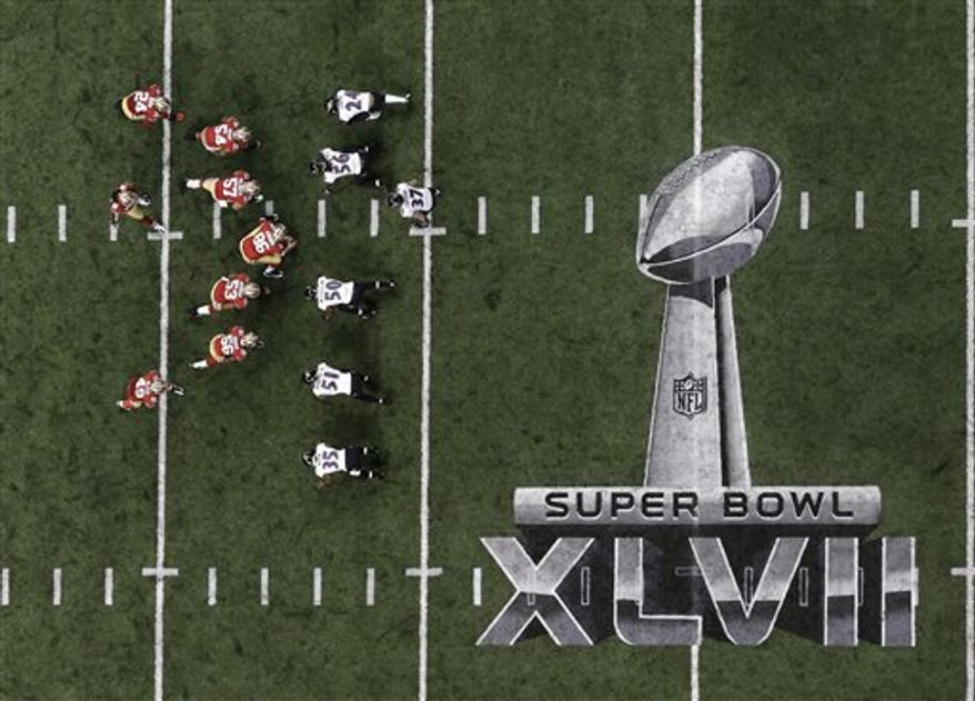 Players line up on the field during the first half of the NFL Super Bowl XLVII football game between the San Francisco 49ers and the Baltimore Ravens Sunday, Feb. 3, 2013, in New Orleans. (AP Photo/Tim Donnelly)